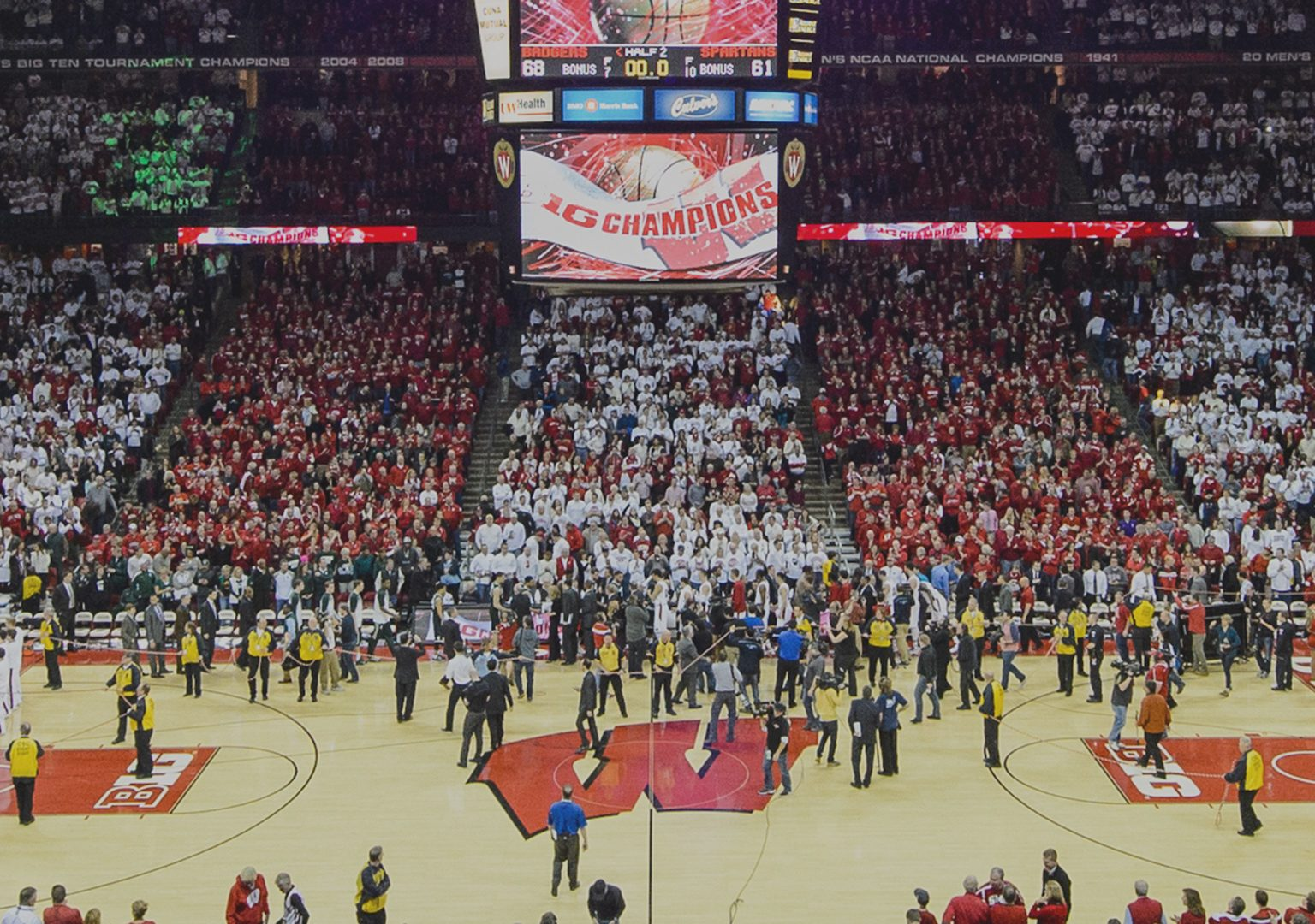 Long view of basketball court and stands filled with fans during a UW Badger basketball game