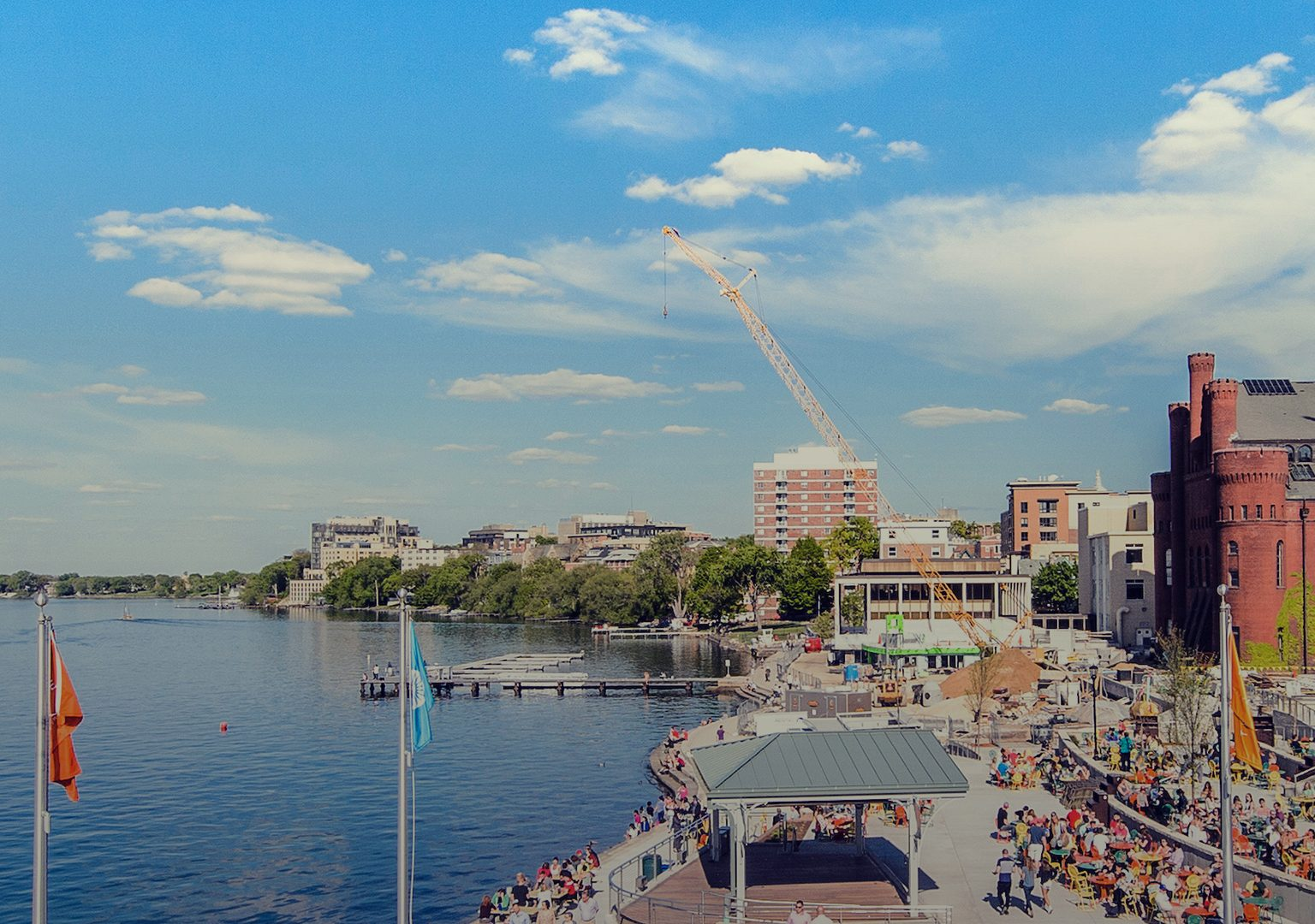 Long view of Memorial Union Terrace and its patrons and Lake Mendota on sunny day