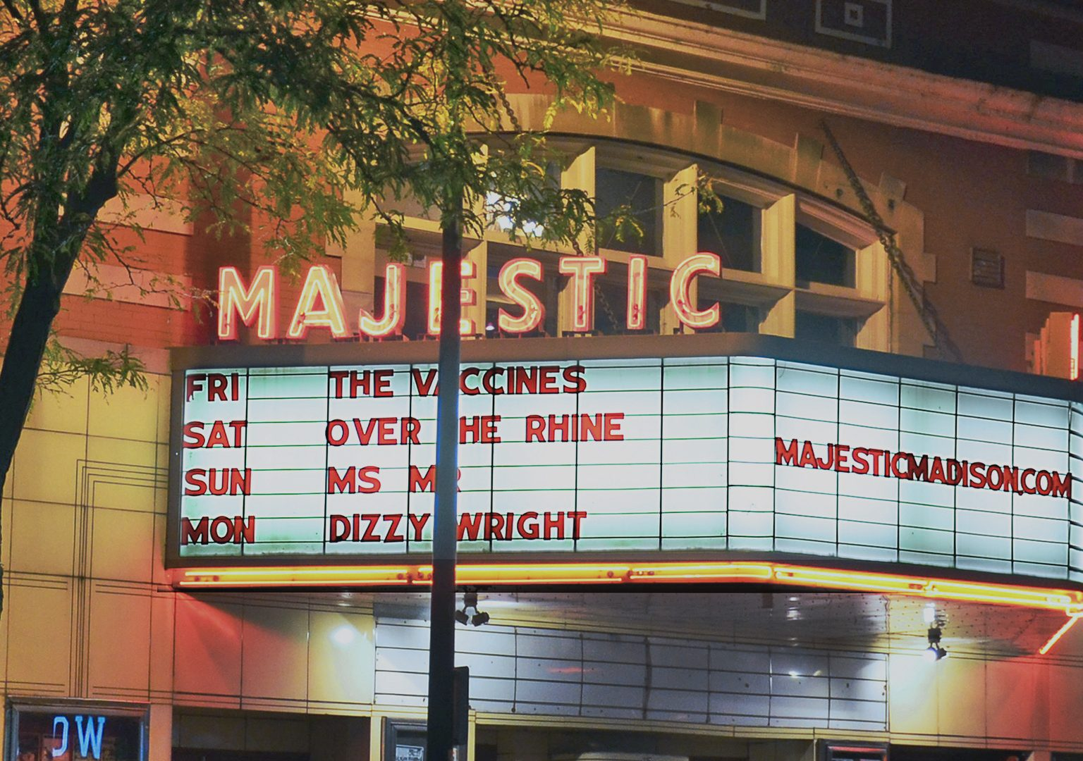 View of illuminated Majestic Theater marquee from across a street at night